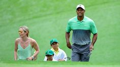 Masters champion Tiger Woods walks to No. 1 with his children Sam and Charlie, girlfriend Lindsey Vonn and fellow champion Mark O'Meara during the Par 3 Contest