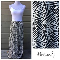 """Ann Taylor Black & White Midi Skirt Brand: Ann Taylor Material: 94% Rayon, 6% Spandex Size: S Color: White and Black Waist: 30"""" (stretchy) Length: 39""""  CLOSET RULES: No PayPal, holds, or trades. Reasonable offers through offer button.  BUYER PROTECTION: After purchase items are subject to extra photo/video with date & buyer closet name. Ann Taylor Skirts Maxi"""