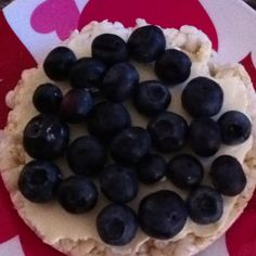 Rice cake topped with light laughing cow cheese and blueberries...one of my favorite low cal snacks right now! Less than 100 calories.