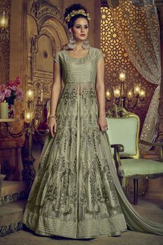 Delectable olive green designer lehenga style suit online which is crafted from net fabric with exclusive zari embroidery and stone work. This stunning designer lehenga style suit comes with banglori silk bottom and net dupatta. Long Choli Lehenga, Green Lehenga, Silk Lehenga, Anarkali Dress, Anarkali Suits, Party Wear Lehenga, Party Wear Dresses, Eid Dresses, Bridal Dresses