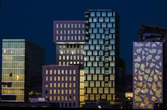 The sunset is reflected in the buildings of The Barcode Project in Oslo, Norway. The new high-rise buildings are part of a redevelopment on former dock and industrial land in the city. Amazing Architecture, Contemporary Architecture, Architecture Design, Beautiful Norway, Colourful Buildings, High Rise Building, Construction, Urban Life, The Washington Post