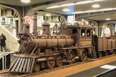 Steampunk Tendencies | Belcolade Express - Andrew Farrugia The World's longest chocolate structure in the world. 784 hours of work, 2,755 pounds of chocolate to make the train 35 meters. http://www.steampunktendencies.com/post/83308815103