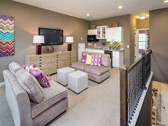 Second floor bonus room. Armless couches. TV. Blonde wood dresser. Kitchenette. Litchfield II A Floor Plan. #11 in slideshow