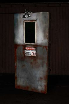 so what exactly is an ANIMATRONIC DOOR Haunted House Prop? it is a door with a LCD that resembles a window showing a corridor on 'the other side of the door'. a dude that appears to be an. Halloween Zombie, Asylum Halloween, Halloween 2014, Modern Halloween, Outdoor Halloween, Haunted Maze, Haunted House Props, Halloween Haunted Houses, Haunted Diy