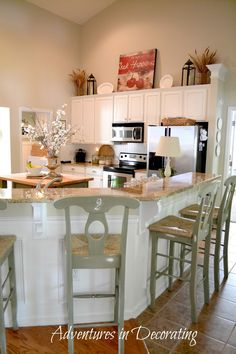 Adventures in Decorating: HOUSE TOUR.above cabinet decor Kitchen Stools, New Kitchen, Kitchen Decor, Kitchen Ideas, Bar Stools, Kitchen White, Kitchen Backsplash, Decorating Above Kitchen Cabinets, Above Cabinets