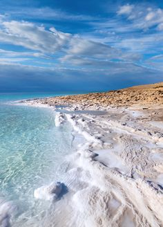 The Dead Sea coastline.  The Dead Sea borders Jordan, Palestine and Israel.  Because of high salt content, it feels like you are floating even when swimming.  Photo: Nickolay Vinokurov