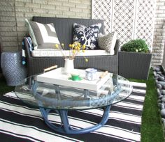 To add another room to his home, Lam maximized his outdoor balcony space. He found the coffee table on the side of the road. Tim Welsby of B...