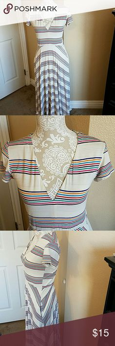 Lovestitch Beautiful Striped Dress NWT size M Beautiful Cream V Neck Dress with Rainbow Stripes Stretchy and Comfy. The top is lined the bottom is not It has pockets!!! Long! Too long for me sadly as it is so pretty! Would easily fit an 8/10 Lovestitch Dresses