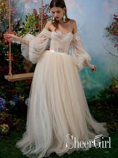 18 Fairytale Wedding Dresses for an Enchanted, Whimsical Look is part of Wedding dress trends - Traditional lace no more! Pearlescent colors, florals, and floaty fabrics are just some of the details we're loving on these modern fairytale wedding dresses Fairy Wedding Dress, Fairytale Dress, Wedding Dress Trends, Dream Wedding Dresses, Bridal Dresses, Wedding Gowns, Prom Dresses, Princess Fairytale, Whimsical Wedding Dresses