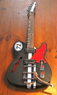 Fender Telecaster thin-line 72 custom. That's my dream guitar.