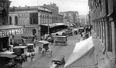 STREETSCAPE:  Portland, Oregon wagons and businesses along Front Avenue, circa 1910