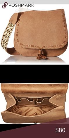 "Steve Madden Bswiss Guitar Saddle Bag NWT Steve Madden ""Bswiss"" crossbody saddle bag. Camel color. Size is 10 x 9 x 3 inches. Beautifully embroidered guitar strap has a 19 inch drop. Magnetic snap flap closure and gold colored hardware. Brand new, Never used! Steve Madden Bags"