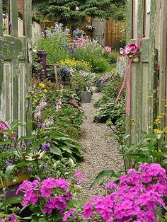 Create a Country Garden cover an existing sidewalk with pea gravel....add a door to nowhere on your fence....create a focal point or purpose...when will i use it the most