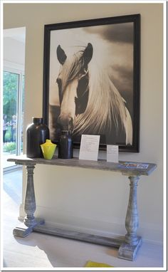 Console table in the 2012 Showhome entryway via Desire to Decorate. | Order your tickets here for a chance to win this home: http://www.helpconquercancer.ca/welcomehome/tickets.php  #PrincessMargSweeps