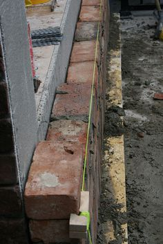 All the original red brick removed from the interior walls is being repurposed for the exterior of the building