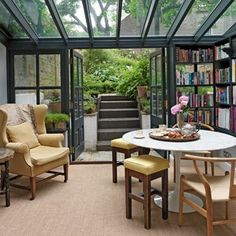 i don't care too much for the decor but the concept of a library that opens to a garden or patio is very appealing