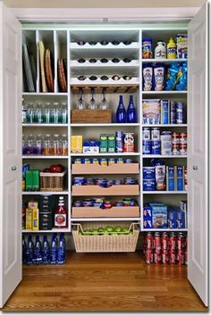 small space pantry ideas... I like the bottle storage up top, the pull out drawers. vertical shelves, etc.