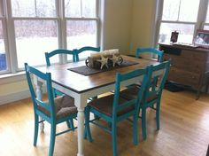 Refinish dining room table with beach theme. The table used to be all black. Primed legs and painted white. Sanded down table top and stained pine.  The chairs had broken spindles along the back. We removed the spindles and sanded down the chairs. We chose a beautiful turquoise color. We coated everything with Vermont natural coating. The centerpiece is a Texas sugarmold candle holder, and two large Bahamian starfish set on a brown beaded runner.