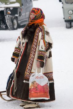 A Khanty woman in traditional dress at a Spring festival in the village of Pitlyar. Yamal, Western Siberia, Russia