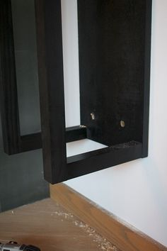 Drywall toggles are a great way to hang something heavy on the wall! Industrial Fireplaces, Firewood Holder, Pocket Hole, Drywall, House Ideas, Mirror, Diy, Home Decor, Drawing Rooms