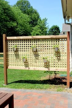 This cedar wood screen adds loads of character to a back yard, is budget friendly, and gives an outdoor patio space extra privacy.