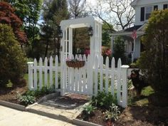 White picket fence garden gate and arbor. love the lights picket gate, whit Picket Fence Gate, White Picket Fence, Arbor Gate, Garden Arbor, Garden Fencing, Garden Archway, White Vinyl Fence, Farmhouse Garden, Farmhouse Decor