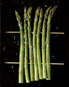 Asparagus  Use spears that are no thicker than 1/2 inch. Bunch together 6 or 7 trimmed spears: Thread a skewer through upper third of spears, gently turning skewer to keep spears from breaking. Repeat at bottom. Brush with olive oil; season with salt and pepper. Grill over medium-high heat, turning once, until marked and just tender, about 9 minutes total. Serve with grilled lemon halves, if desired.
