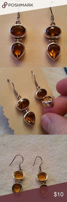 Unique Hinged Amber glass earrings Unusual earrings featuring amber glass set in silver toned bezel. Each earring is hinged in the middle so it has some nice movement. Nice amber color and fun to wear. Comes from nonsmoking home and I ship quickly. Jewelry Earrings