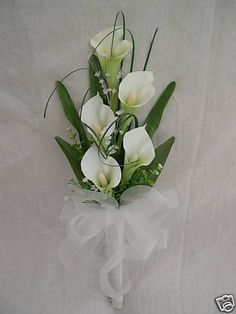 we make all bouquets to high standard, we use with bouquets lace and ribbons all colours we use , we use silk or foam flowers for these only .