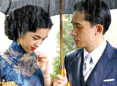 Shen Teh and Yang Sun in the rain - like the umbrella.  湯唯<色•戒>