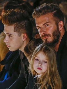 david-beckham-sits-with-his-son-brooklyn-and-his-daughter-harper-during-a-presentation-of-the-victoria-beckham-fall-winter-2015-collection-during-new-york-fashion-week.jpg (624×826)