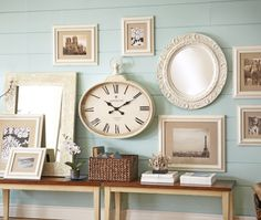 Mix mirrors, clocks and frames but match color for a vintage-inspired look