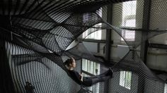 "A ""community hammock,"" installed at the House for Contemporary Art in Hasselt, Belgium."