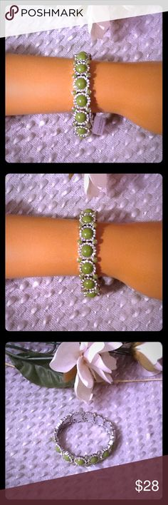 Lia Sophia NWT Stretch Bracelet Green Silver Beautiful Lia Sophia stretch bracelet, NWT, beautiful olive green stones surrounded by clear crystal rhinestones, should fit any wrist size. Bundle to save 15% off your purchase of 2 or more items from my closet! Lia Sophia Jewelry Bracelets