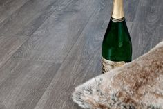 """We also succeeded in making a darker tone of grey """"driftwood"""" in laminate flooring. When developing this design, we were inspired by 400 years old exclusive walls of timber. The surface is added new technology, which complete the feeling of real wood. Each of the planks has bevelled edges (V Grooves) on all four sides resulting in very distinctive groove between the planks, adding more depth and dimension along with giving an individual definition to each plank."""