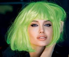 Angelina Jolie with short light platinum green colored hair. ***** Referenced by Web Hosting With A Dollar (WHW1.com): WebSite Hosting - Affordable, Reliable, Fast, Easy, Advanced, and Complete.©