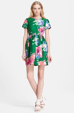 Free shipping and returns on kate spade new york 'stelli' floral print fit & flare dress at Nordstrom.com. Vivid blossoms tumble down a charming short-sleeve fit-and-flare dress styled with a flouncy skirt and a signature bow above the back-baring keyhole.