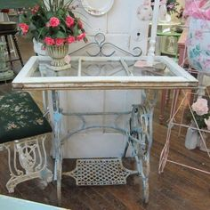 A gorgeous repurpose using a discarded window and an old sewing machine base....