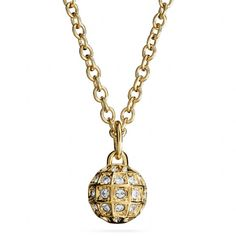 The Short Beveled Pave Ball Necklace from Coach - #ABrilliantSeason  Suspended from a delicate fine-link chain and washed in lavish gold plating, this elegant sphere sparkles with Swarovski crystals in distinctive beveled settings.