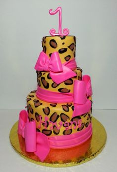 Leopard Print First Birthday - The customer sent me a photo of a cake similar to this created by Pink Cake Box...this is my version. Buttercream icing with fondant spots and bows.