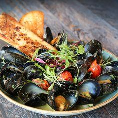 black bear bay mussels, green curry sauce, grape tomato, cilantro, ciabatta toast Ciabatta, Green Curry Sauce, Weekly Specials, Mussels, Cilantro, Toast, Vegetables, Food, Essen