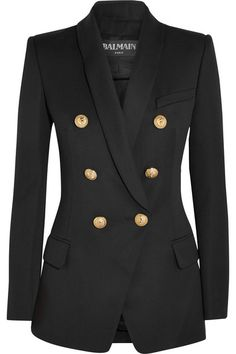 Balmain's classic blazer will never go out of style. Designed to emphasize a slim profile, this wool piece features lightly padded shoulders and signature embossed gold buttons that narrow at the waist. Keep your look low-key with boyfriend jeans.