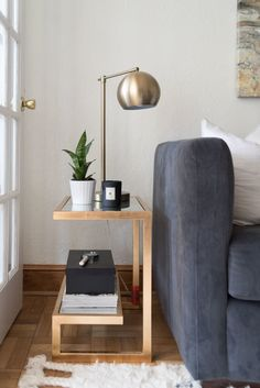 Fun geometric side table with chrome lamp: http://www.stylemepretty.com/living/2016/09/08/from-empty-apartment-to-killer-bachelorette-pad-for-under-5k/ Photography: Laura Metzler - http://www.laurametzler.com/