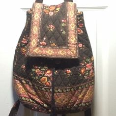 Vintage Vera Bradley backpack and wallet Bought a while ago. The pattern is retired making it more valuable. Comes with matching wallet. Comment with any questions! Vera Bradley Bags Backpacks