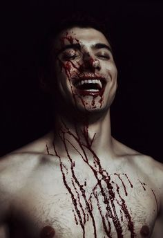 ||he laughed as the warm blood from his opponent splattered against him||