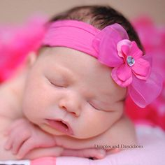 baby headband with a soft nylon band accented with organza bow and flower**20-