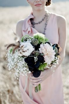 I love the moss greens and black that are incorporated in this bouquet! Gives it a very unique touch!