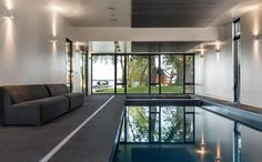 This industrial modern house has an indoor swimming pool with direct access to the lakeside of the property. #IndoorPool #SwimmingPool