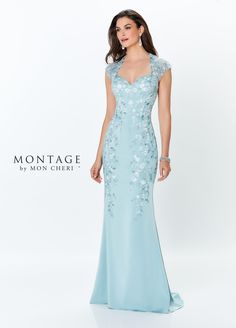 Montage by Mon Cheri 119952 This luxurious stretch crepe fit and flare gown offers an embroidered illusion cap sleeves that creates a Queen Anne neckline and a matchin Mother Of The Bride Dresses Long, Mothers Dresses, Queen Anne Neckline, Beach Wedding Groom, Montage By Mon Cheri, Fit And Flare Wedding Dress, Mob Dresses, Dressy Dresses, Bride Gowns