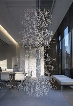 Wall of type signage. Love the jumbled messy feel of this particular signage design. Wayfinding Signage, Signage Design, Typography Design, Environmental Graphic Design, Environmental Graphics, Office Interior Design, Office Interiors, Corporate Design, Retail Design